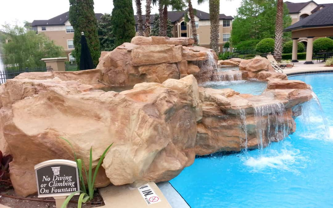 Custom RicoRock Swimming Pool Waterfall at an Apartment Complex