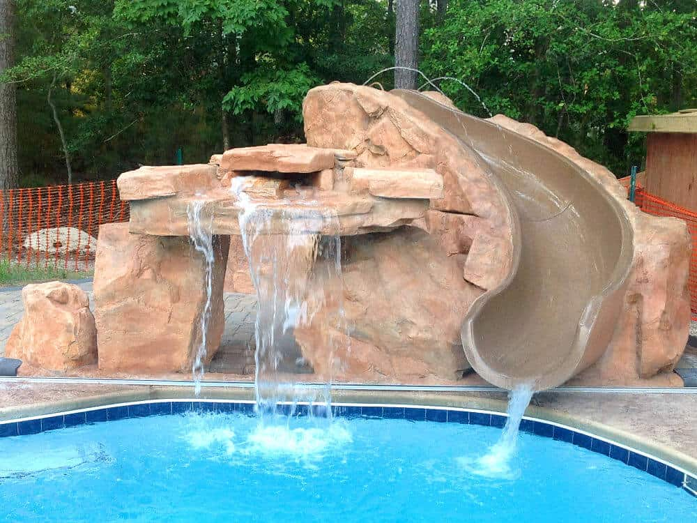 Ricorock slide package w inter fab slide ricorock inc for Pool with rock waterfall and slide