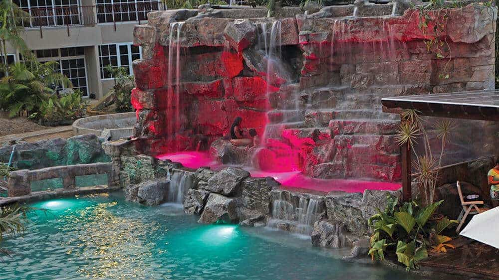 Custom RicoRock Waterfall w/ Lighting at Jacana Resort