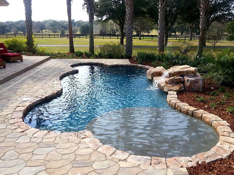 Texas 2 step swimming pool waterfall kit ricorock inc for Prefab inground pools
