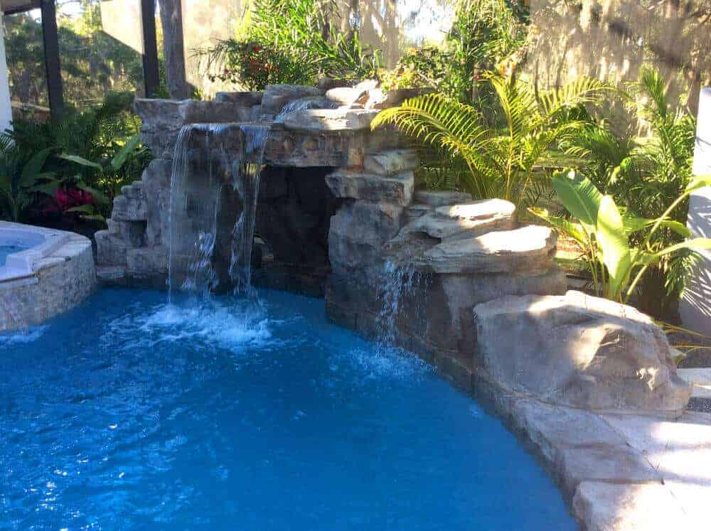 Creative ricorock grotto application on a swimming pool for Pool design app