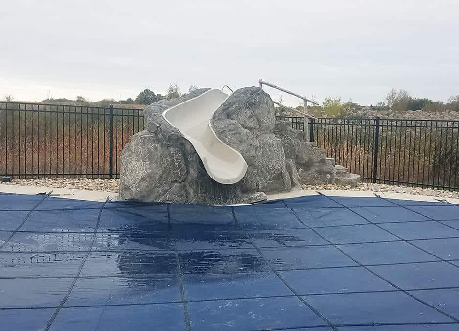 Fiberglass slide with RicoRock boulders and steps