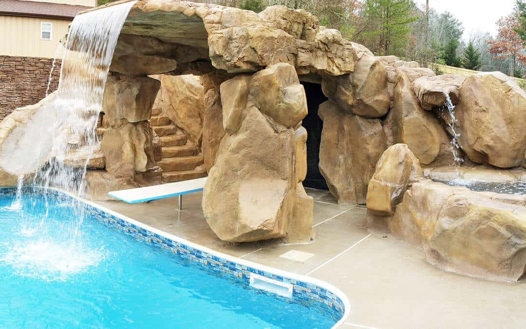 You know you want your swimming pool area to have a mini-cave like this!!