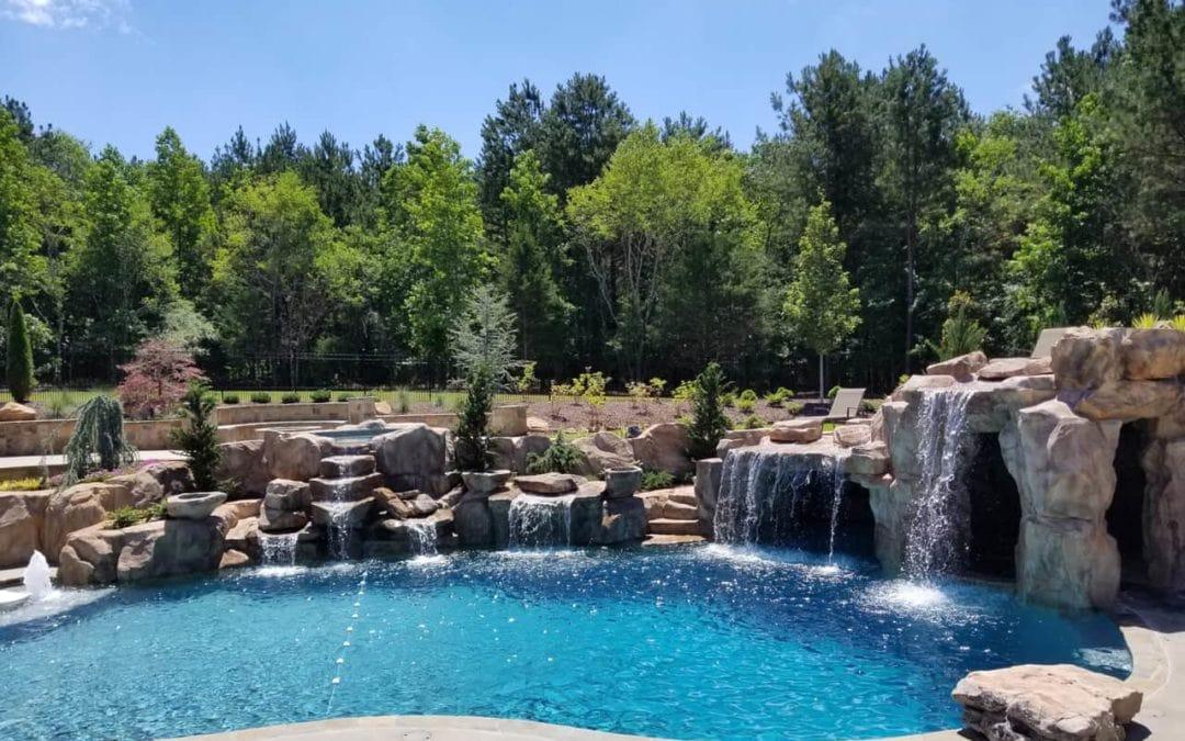 Custom Artificial Rock Grottos & Waterfalls in Backyard Paradise