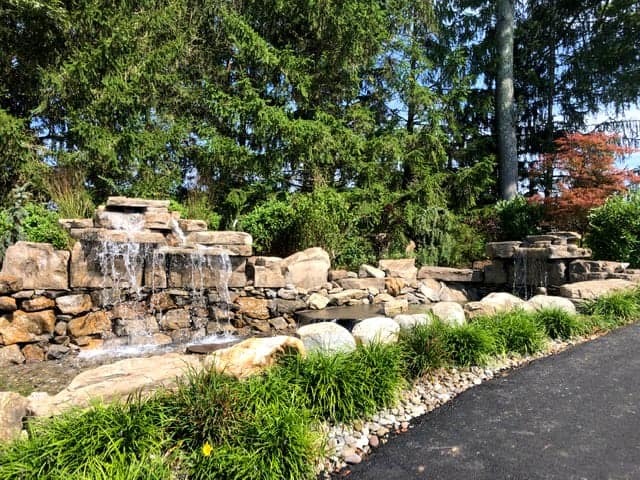 RicoRock 4 Foot Double and 3 Foot Modular Faux Rock Waterfall Kits at a Golf Course