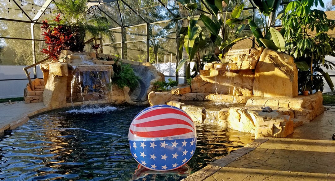 Backyard Oasis Featuring Custom Faux Rock Waterfall & Grotto
