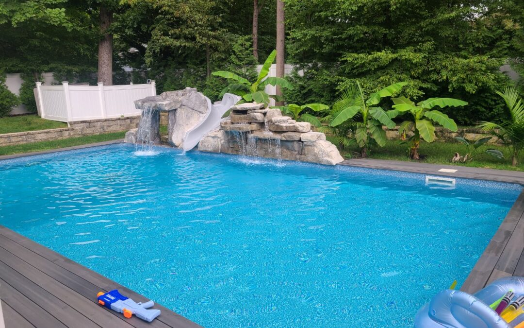 swimming pool with ricorock 4 ft double waterfall, grotto and a water slide.