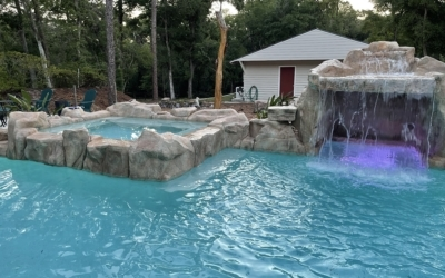 Faux Rock Backyard Oasis with a Grotto & Spa