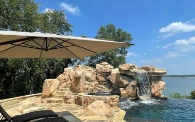 Enhance your backyard pool with a custom grotto and spa